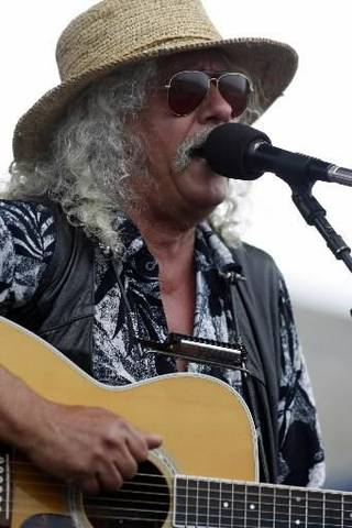 Arlo Guthrie performs at George Wein's Newport Folk Festival 50 in Newport, R.I. on Sunday, Aug. 2, 2009. AP Photo