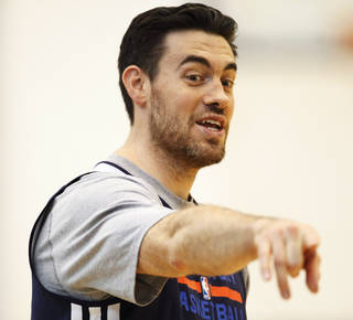 Thunder forward Nick Collison points a spot on the court out at after practice at the Thunder Practice Facility in Oklahoma City on Monday, April 26, 2014. Photo by KT King/The Oklahoman