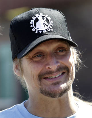 Recording artist Kid Rock smiles during a news conference on Belle Isle in Detroit, Thursday, June 2, 2011 announcing he'll be playing a hometown concert at Detroit's baseball park this summer. Rock, Detroit Red Wings captain Nicklas Lidstrom and retired Red Wings defenseman Chris Chelios used paddle boards to cross the Detroit River to Belle Isle to make the announcement. (AP Photo/Paul Sancya) ORG XMIT: MIPS104