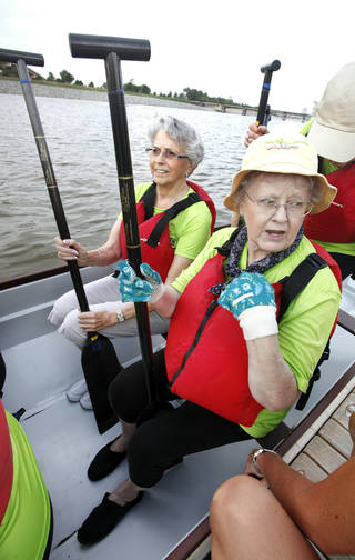 Lois Cain and Gail Kelley load up in the boat as senior citizens from Spanish Cove Retirement Village go dragon boating on the Oklahoma River in Oklahoma City Thursday, Aug. 16, 2012. Photo by Paul B. Southerland, The Oklahoman PAUL B. SOUTHERLAND - PAUL B. SOUTHERLAND