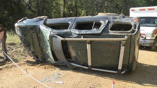 In this photo from video provided courtesy of KXII-TV News 12, an SUV involved in a rollover accident that left a ten-year-old child dead is pictured in Bryan County, near Colbert, Okla. The Oklahoma Department of Public Safety says the crash occurred Sunday about 3:25 p.m. near the town of Colbert. Officials say the 10-year-old girl was ejected from the vehicle and the SUV came to rest on top of her. (AP Photo/KXII-TV News 12)