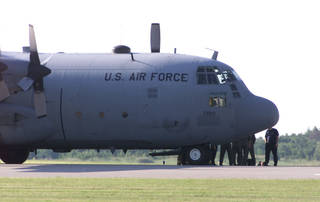 A file photo shows a C-130 Arkansas Air National Guard plane at Wiley Post Airport. Staff photo by Michael Downes. MICHAEL DOWNES