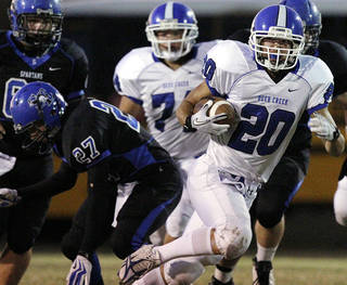 Deer Creek's Brennan Miyake, right, gets past the Southeast defense during a 2011 game at C.B. Speegle Stadium. The Antlers plan to utilize Miyake more in the passing game this season. Photo from The Oklahoman Archives