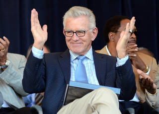 FILE - In this July 21, 2012, file photo, Tim McCarver greets the crowd before accepting the Ford C. Frick Award for excellence in baseball broadcasting as part of the Baseball Hall of Fame Induction ceremonies at Doubleday Field in Cooperstown, N.Y. McCarver says he will step down from his position at Fox after this season. (AP Photo/Heather Ainsworth, File) ORG XMIT: NY154