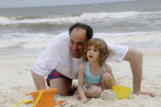 Slain dentist Philip Gattuso in a photo provided by his family with his daughter, Kennedy. Gattuso, formerly of Oklahoma, was killed Oct. 26 at his home in Fargo, N.D. An Oklahoma City man was charged Monday in his death. Provided
