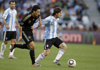 Argentina's Lionel Messi, right, and Germany's Mesut Ozil are seen in July 2010 during the World Cup quarterfinal soccer match between Argentina and Germany at the Green Point stadium in Cape Town, South Africa. AP File Photo Matt Dunham