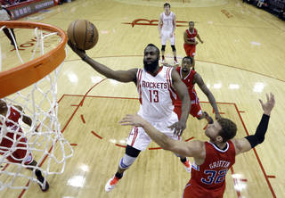 Houston Rockets' James Harden (13) goes up for a layup as Los Angeles Clippers' Blake Griffin (32) defends during the first quarter of an NBA basketball game Tuesday, Jan. 15, 2013, in Houston. (AP Photo/David J. Phillip)