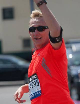 David McCord is shown waving to friends and family while running in the Boston Marathon on April 15. (Provided)