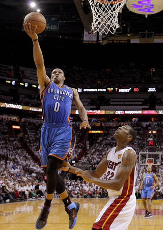 Oklahoma City's Russell Westbrook (0) goes past Miami's James Jones (22) during Game 4 of the NBA Finals between the Oklahoma City Thunder and the Miami Heat at American Airlines Arena, Tuesday, June 19, 2012. Oklahoma City lost 104-98. Photo by Bryan Terry, The Oklahoman