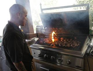 Mark Ridener cooks bacon-wrapped jalapeno-stuffed quail during the Art of Barbecue, a part of Open Flame at American Propane in Oklahoma City. Photo by Garett Fisbeck, The Oklahoman Garett Fisbeck