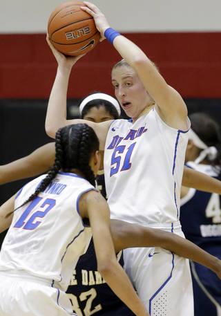 DePaul forward Katherine Harry (51) looks to a pass to guard Brittany Hrynko (12) during the first half of an NCAA women's college basketball game against Notre Dame in Chicago on Sunday, Feb. 24, 2013. Notre Dame won 84-56. (AP Photo/Nam Y. Huh) ORG XMIT: ILNH102