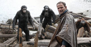 """This photo shows Jason Clarke, as Malcolm, foreground, and, background from left, Andy Serkis, as Caesar; Toby Kebbell, as Koba; and Karin Konoval, as Maurice; in a scene from """"Dawn of the Planet of the Apes."""" AP Photo -"""