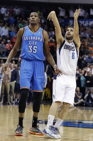 Dallas Mavericks guard Jose Calderon (8) of Spain, watches his 3-point shot go in, next to Oklahoma City Thunder forward Kevin Durant (35) during the fourth quarter of an NBA basketball game Tuesday, March 25, 2014, in Dallas. The Mavericks won 128-119 in overtime. (AP Photo/LM Otero)