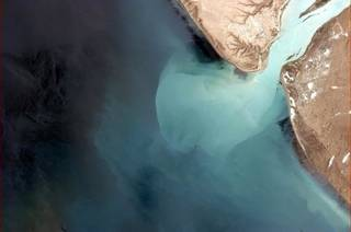 "This photo taken from the International Space Station in orbit above earth by Canadian astronaut Col. Chris Hadfield, as posted on Facebook, shows ""glacial water burping into the Atlantic in deep Southern Argentina,"" as he noted."