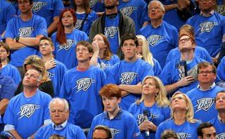 Oklahoma City fans stand during a moment of silence for the 19th anniversary of the Oklahoma CIty bombing during Game 1 in the first round of the NBA playoffs between the Oklahoma City Thunder and the Memphis Grizzlies at Chesapeake Energy Arena in Oklahoma City, Saturday, April 19, 2014. Photo by, Sarah Phipps, The Oklahoman