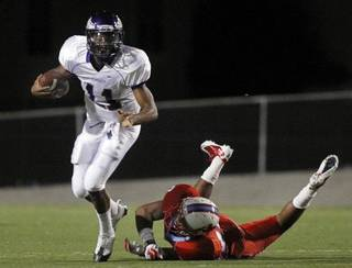 Former Richardson, Texas, standout Torrance Carr (11) eludes a Dallas Skyline blitzer last season. Carr has signed with Oklahoma State and believes he can step in alongside Justin Blackmon. PHOTO COURTESY DALLAS MORNING NEWS TOM FOX/Staff Photographer
