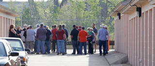 Bidders gather Wednesday for a storage unit auction at Public Storage, 8012 S Santa Fe in Oklahoma City. Photo by Paul B. Southerland, The Oklahoman