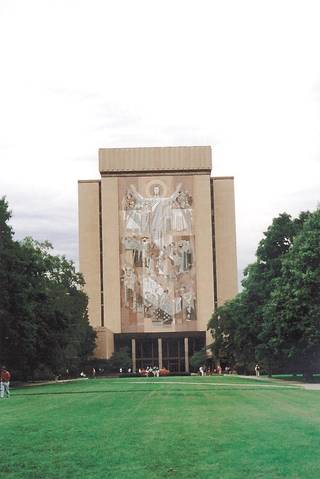 "Notre Dame's ""Touchdown Jesus"" - In the background is the Hesburgh Library which features the mural nicknamed ""Touchdown Jesus"""