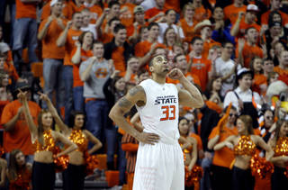 Oklahoma State's Marshall Moses (33)Êcelebrates the Cowboys win over the Sooners during the Bedlam men's college basketball game between the University of Oklahoma Sooners and Oklahoma State University Cowboys at Gallagher-Iba Arena in Stillwater, Okla., Saturday, February, 5, 2011. Photo by Sarah Phipps, The Oklahoman