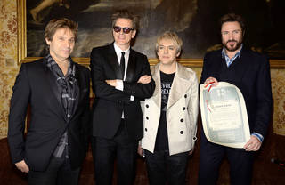 """Duran Duran is still touring 20 months after the release of the acclaimed album """"All You Need is Now."""" Pictured from left are drummer Roger Taylor, guitarist John Taylor, keyboardist Nick Rhodes, and vocalist Simon Le Bon after being given a lifetime achievement award in Milan, Italy, in 2011. AP Photo"""
