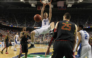 Duke's Mason Plumlee (5) dunks as Maryland's Alex Len (25) and Nick Faust (5) look on during the second half of an NCAA college basketball game at the Atlantic Coast Conference tournament in Greensboro, N.C., Friday, March 15, 2013. Maryland won 83-74. (AP Photo/Gerry Broome)