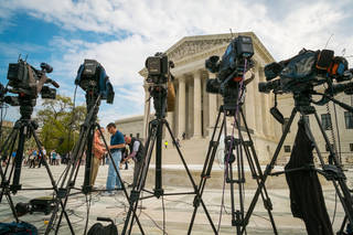 Videojournalists set up outside of the Supreme Court on Tuesday in Washington. AP Photo J. David Ake - AP