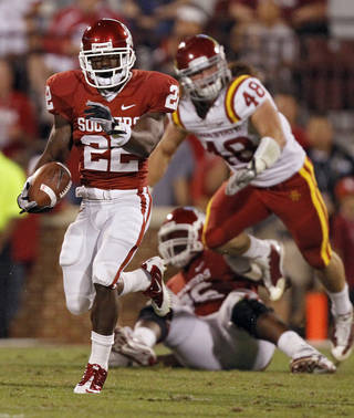 Oklahoma's Roy Finch (22) breaks a run into the Iowa State secondary during the first half of the college football game between the University of Oklahoma Sooners (OU) and the Iowa State Cyclones (ISU) at the Glaylord Family-Oklahoma Memorial Stadium on Saturday, Oct. 16, 2010, in Norman, Okla. Photo by Chris Landsberger, The Oklahoman