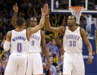 Oklahoma City's Kevin Durant (35) celebrates with Russell Westbrook (0) and Serge Ibaka (9) during an NBA game between the Oklahoma City Thunder and the Sacramento Kings at Chesapeake Energy Arena in Oklahoma City, Friday, March 28, 2014. Oklahoma City on 94-81. Photo by Bryan Terry, The Oklahoman