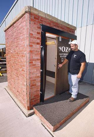 Andrew Zagorski Jr., vice president of Oz Saferooms, shows a model safe room at the factory at 3216 SE 30 in Del City. PAUL B. SOUTHERLAND - The Oklahoman