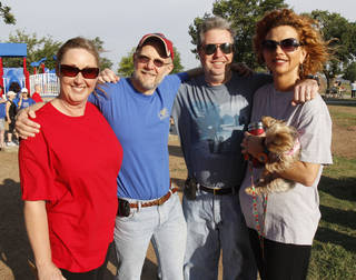 "Michelle Statham (left), Chris Flanagan, James Allen, and Tracy Leeper and her dog ""Kiki"" participate in the NAMI (National Alliance on Mental Illness) walk at Stars and Stripes Park in Oklahoma City, OK, to raise money for mental illness causes, Saturday, May 19, 2012, By Paul Hellstern, The Oklahoman"