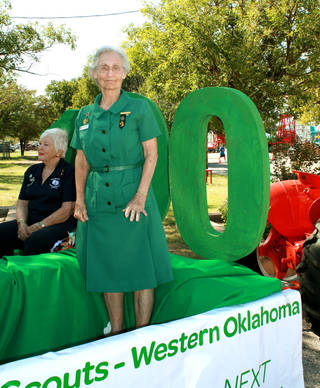 Ione Brown, seated, and Joan Smith were among 10 longtime leaders who rode the Girl Scout centennial float on Senior Day at the Oklahoma State Fair. Smith was wearing the uniform she wore when she became a Scout leader in the 1950s. PHOTO PROVIDED