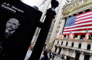 FILE - This Monday, Sept. 29, 2008, file photo, shows a picture of financier J.P. Morgan across the street from the New York Stock Exchange in New York. Two former JPMorgan Chase & Co. traders were accused Wednesday, Aug. 14, 2013, of trying to conceal the size of the investment bank¬aas $6 billion trading loss in 2012 in criminal conspiracy charges that raised fresh questions about whether Wall Street learned its lessons from the 2008 financial crisis (AP Photo/Stephen Chernin) ORG XMIT: NYBZ131