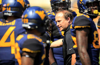 West Virginia coach Dana Holgorsen, center, reacts to a bad play by his special teams during the fourth quarter of their during NCAA college football game against William & Mary in Morgantown, W.Va., on Saturday, Aug. 31, 2013. West Virginia won 24-17. (AP Photo/Christopher Jackson) ORG XMIT: WVCJ107