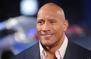 LONDON, UNITED KINGDOM - MARCH 18: Dwayne Johnson attends the UK Premiere of G.I. Joe: Retaliation at Empire Leicester Square on March 18, 2013 in London, England. (Photo by Stuart Wilson/Getty Images)