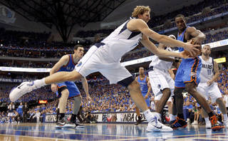 Dirk Nowitzki (41) of Dallas and Oklahoma City's Serge Ibaka (9) go for the ball during game 2 of the Western Conference Finals in the NBA basketball playoffs between the Dallas Mavericks and the Oklahoma City Thunder at American Airlines Center in Dallas, Thursday, May 19, 2011. Photo by Bryan Terry, The Oklahoman
