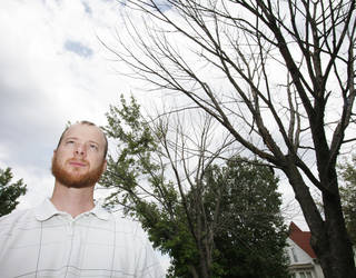 Ryan Ochsner, urban forestry coordinator for the city of Edmond, shows two silver maples, one that is completely dead and another with about 80 percent of the canopy dead. Many trees have been weakened by the drought in 2011. Photo by David McDaniel, The Oklahoman