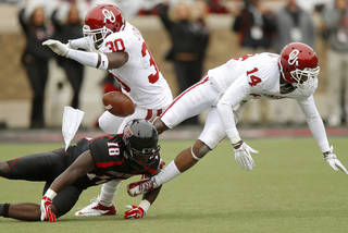Oklahoma's Javon Harris (30) and Aaron Colvin (14) break up a pass intended for Texas Tech's Eric Ward (18) during a college football game between the University of Oklahoma (OU) and Texas Tech University at Jones AT&T Stadium in Lubbock, Texas, Saturday, Oct. 6, 2012. Oklahoma won 41-20. Photo by Bryan Terry, The Oklahoman