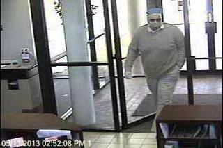 Surveillance photos of a robbery at Bank of Oklahoma, 11300 N May Avenue, on the afternoon of May 13.
