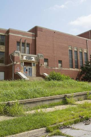 Page Woodson Elementary School sits abandoned on July 29 on the corner of Noth E 6 Street and N High Avenue. When open, notable people sucah as Clara Luper and Ralph Ellington attended as children. Photo by Chris James, The Oklahoman Chris James