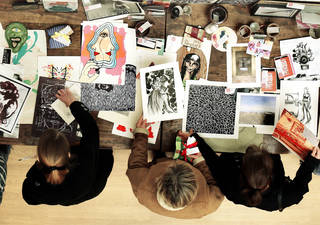 Attendees at a Valentine's Day fundraiser sponsored by the University of Oklahoma School of Art and Art History look over art produced by students and faculty. PHOTOs BY STEVE SISNEY, THE OKLAHOMAN
