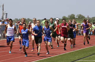 The field runs the first leg the boys 2 A 3200 meter relay at Carl Albert high school in Midwest City, Friday May 09, 2014. Photo By Steve Gooch, The Oklahoman