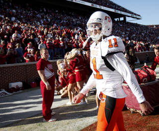 OSU's Zac Robinson walks off the field after the Bedlam college football game between the University of Oklahoma Sooners (OU) and the Oklahoma State University Cowboys (OSU) at the Gaylord Family-Oklahoma Memorial Stadium on Saturday, Nov. 28, 2009, in Norman, Okla. Photo by Bryan Terry, The Oklahoman