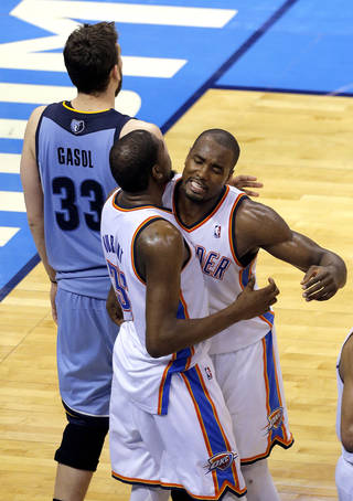 Oklahoma City's Serge Ibaka (9) and Kevin Durant (35) celebrate Durant's miracle 3-point basket in front of Memphis' Marc Gasol (33) during Game 2 in the first round of the NBA playoffs between the Oklahoma City Thunder and the Memphis Grizzlies at Chesapeake Energy Arena in Oklahoma City, Monday, April 21, 2014. Photo by Sarah Phipps, The Oklahoman