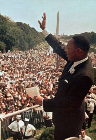 "** FILE ** The Rev. Martin Luther King Jr. acknowledges the crowd at the Lincoln Memorial for his ""I Have a Dream"" speech during the March on Washington, D.C., in this Aug. 28, 1963 file photo. Supporters of a proposal to rename a street in Muncie, Ind., in honor of the slain civil-rights leader said they will stage a protest on Aug. 9, 2003, the same weekend that hundreds of black former residents visit the city, the Whiteley Neighborhood Council announced Thursday, July 31, 2003. (AP Photo, FIle)"