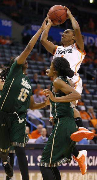 Oklahoma State's Brittany Atkins (1) tries to get around South Florida's Shavontae Naylor (15) and Courtney Williams (10) during the All-College Classic women's basketball game between Oklahoma State University and South Florida at Chesapeake Energy Arena in Oklahoma City, Okla., Saturday, Dec. 14, 2013. Photo by Bryan Terry, The Oklahoman