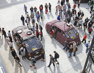 Norman High School students inspect Reed Timmer's storm-chasing vehicles Thursday. Timmer, who is with the Discovery Channel, showed off the specially designed Dominator 1 and Dominator 2 cars to both Norman High and Norman North High School students. PHOTOS BY STEVE SISNEY, THE OKLAHOMAN
