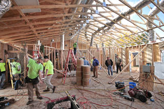 "Volunteers work on the salutary in the Landmark United Pentecostal Church, Friday, November 1, 2013. About 300 volunteers will be in Yukon on Friday to participate in ""Church in a Day"" -- a church building project that will see volunteers construct a 2,900-square-foot church buidling on Friday and Saturday with services at the church on Sunday. Photo by David McDaniel, The Oklahoman"