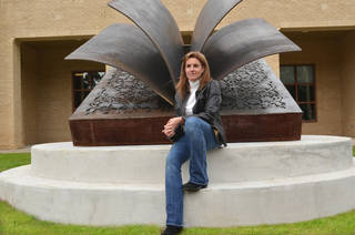 Deedee Morrison poses with one of her sculptures. Photo provided Photo provided