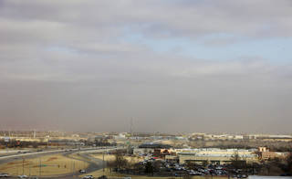 Winds whip up a cloud of dust and haze close to the ground as high winds move through Oklahoma City on Thursday morning. Photo by Paul B. Southerland, The Oklahoman PAUL B. SOUTHERLAND -