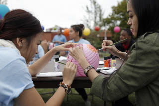 Thao Dao, left, and Jill Truong make a lantern during the Asian Moon Festival at the University of Central Oklahoma. PHOTO BY SARAH PHIPPS, THE OKLAHOMAN. SARAH PHIPPS - THE OKLAHOMAN